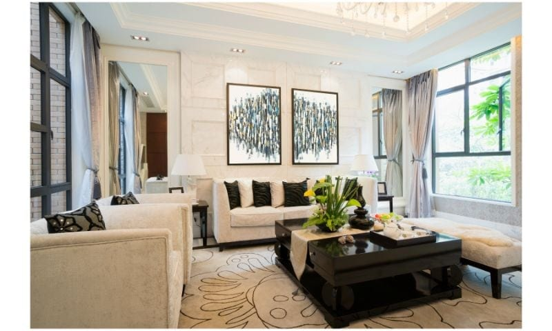 Beautifully Staged Room with Artwork, Chairs and Wooden Table